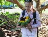 1. Dr. Amy Eisenberg inspecting rotting Pandanus fruit. IMG_9159.jpg