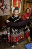 Hlib Jiangl Village, Guizhou Province: Mother exhibiting dress made for her daughter. The design is intergenerational. _010.jpg