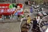 One of two main walkways over the main street in  Jishou City, Hunan Province, China.