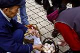 Chicken eggs being sold on sidewalk market.
