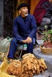 Selling tobacco leaves. Jishou City, Hunan Province, China