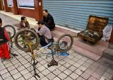 Sidewalk bicycle repairman.  Jishou City, Hunan Province, China