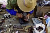 Shoemaker repairing heel. Dali, China.