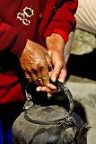 Woman holding a teapot. Dali, China.