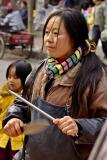 Butcher in outdoor market. Jishou City China. .jpg