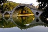 Bridge over lake at Jishou University Jishou China.