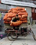 Moving some potatoes. Jishou City, China.