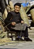 Splitting bamboo for basket making. Dehang Village, China.