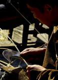 Splitting bamboo for basket making. Dehang Village, Hunan Province, China