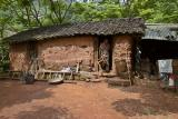 Adobe home situated on the shore of a lake near Ping Shan Po.