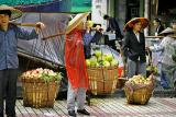 Sidewalk produce in the rain.