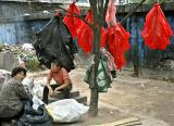 Recycling red plastic bags.