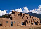 A multi story adobe residence used by tribal members.