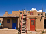 A two story adobe structure