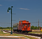 A  view  of the exhibit cars parked at the Llano , TX station