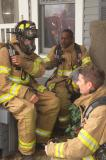 Three Firefighters who had just left the building when it was decided to get out!