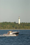 Black Beauty, Classic Chris Craft rounding Preque Isle Lighthouse-Lake Huron, MI