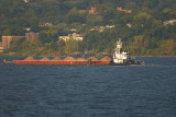 Tug pushing barge up Hudson River