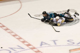 Milan Michalek and Sidney Crosby slide on the ice