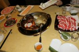 Hot pot, with  dish of tripe on left