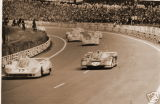 PORSCHE 917L OF SIFFERT-BELL LEADS THE FERRARI 512M OF DONOHUE-HOBBS AFTER THE START, LE MANS 1971