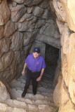 Mycenae - Malcolm coming out of cistern  at Mycenae.jpg