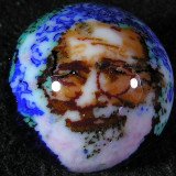 0.90 One of Chris' cane style marbles, also done on the sphere grinder, using a chunk of Jerry Garcia cane.