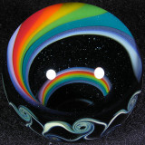 Beautiful dark sparkle glass is seen between the lines of the rainbow.