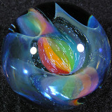 Kevin's special rainbow silver fume cane is twisted all through this marble.