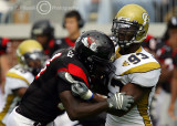 Jackets DE Michael Johnson fights off the block of GWU RB Philip Peoples