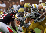 Jackets OT Andrew Gardner takes on Bulldogs LB Oluwadamilola Teniola in an effort to spring RB Cox for a gain