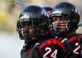 Gardner-Webb DB Terron Williams and teammates nervously eye the clock as it ticks down in the fourth quarter
