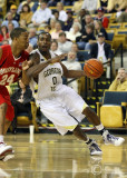 Yellow Jackets G Lewis Clinch attempts to turn the corner along the baseline against Terrapins G Cliff Tucker
