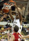 Georgia Tech F Alade Aminu slams home a powerful dunk