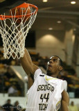 Yellow Jackets F Aminu goes in for a breakaway dunk