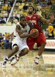 Georgia Tech G Clinch makes a move while Maryland G Mosley attempts to cut him off