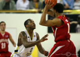 Yellow Jackets G Clinch defends against Terrapins G Mosley