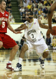 Jackets G Miller reacts to the defensive move by Terrapins G Hayes