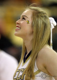 Georgia Tech Yellow Jackets Cheerleader performs during a timeout
