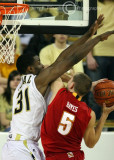 Yellow Jackets F Lawal goes up to stop a shot by Terrapins G Hayes