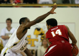 Georgia Tech G Clinch gets ready for a move by Maryland G Mosley