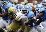 Yellow Jackets B-back Jonathan Dwyer attempts to break away from a pack of Tar Heels defenders