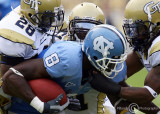 Yellow Jackets defenders surround North Carolina WR Greg Little after a catch