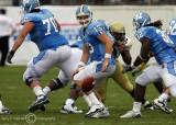 North Carolina QB T.J. Yates turns to go after an errant snap…