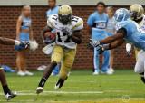 Georgia Tech A-back Orwin Smith breaks through the line of scrimmage…
