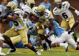…Jackets A-back Smith attempts to break a tackle