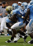 Yellow Jackets A-back Anthony Allen is gang tackled by Tar Heels defenders