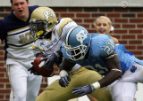 Yellow Jackets A-back Dwyer dives for the end zone but is knocked out of bounds on the one by Tar Heels S Da'Norris Searcy