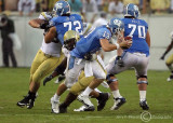 Yellow Jackets DE Morgan attempts to sack Heels QB Yates late in the game…