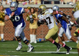 Tech DB Jerrard Tarrant returns the first of his two interceptions on the day